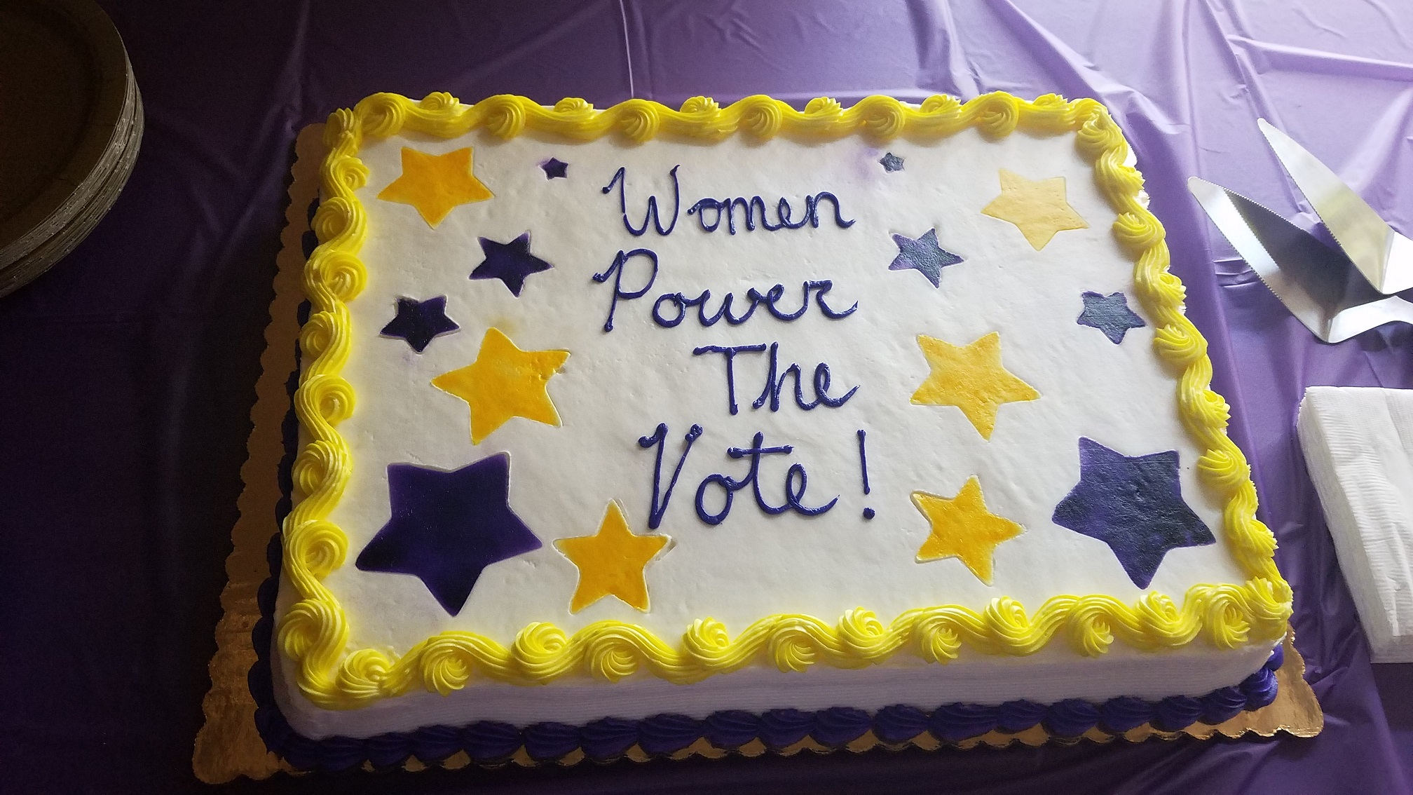 "Decorated cake with message ""Women Power the Vote!"""