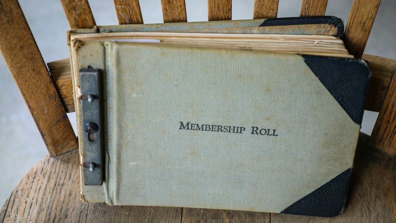 Photo of old fashioned membership roll book