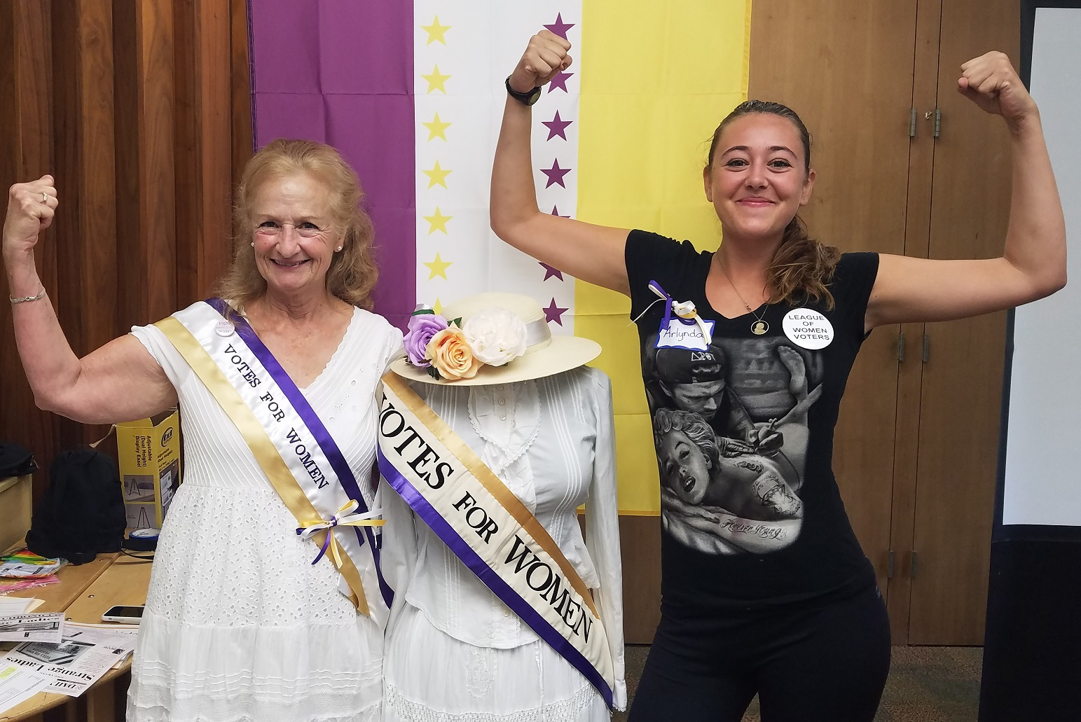 Two women celebrating suffrage with manikin dressed as suffragist
