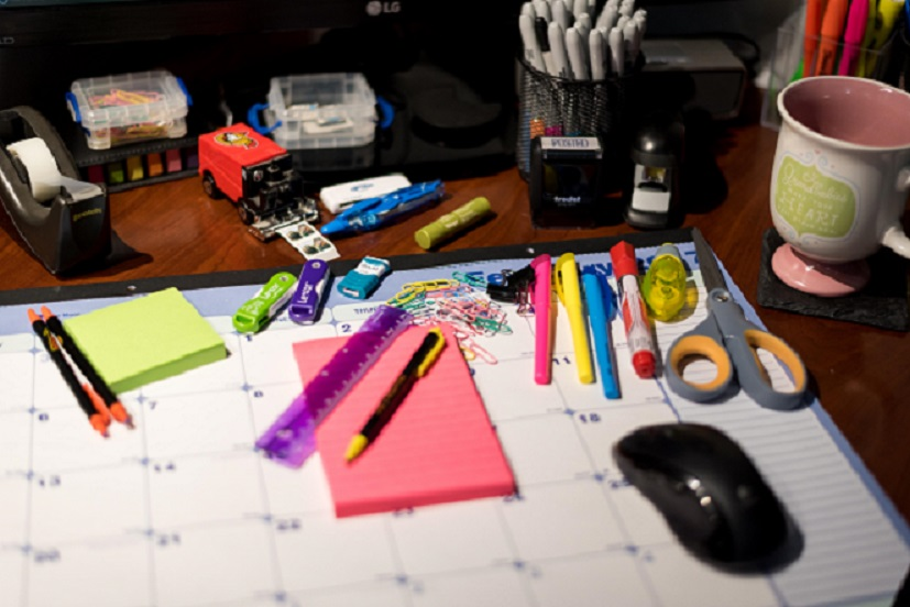 desk calendar, pencils, tape, etc.
