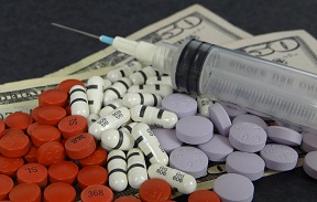 pills, syringe, $50 bills
