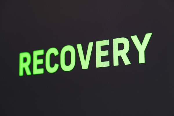 """the word """"Recovery"""" in large glowing green letters on black"""