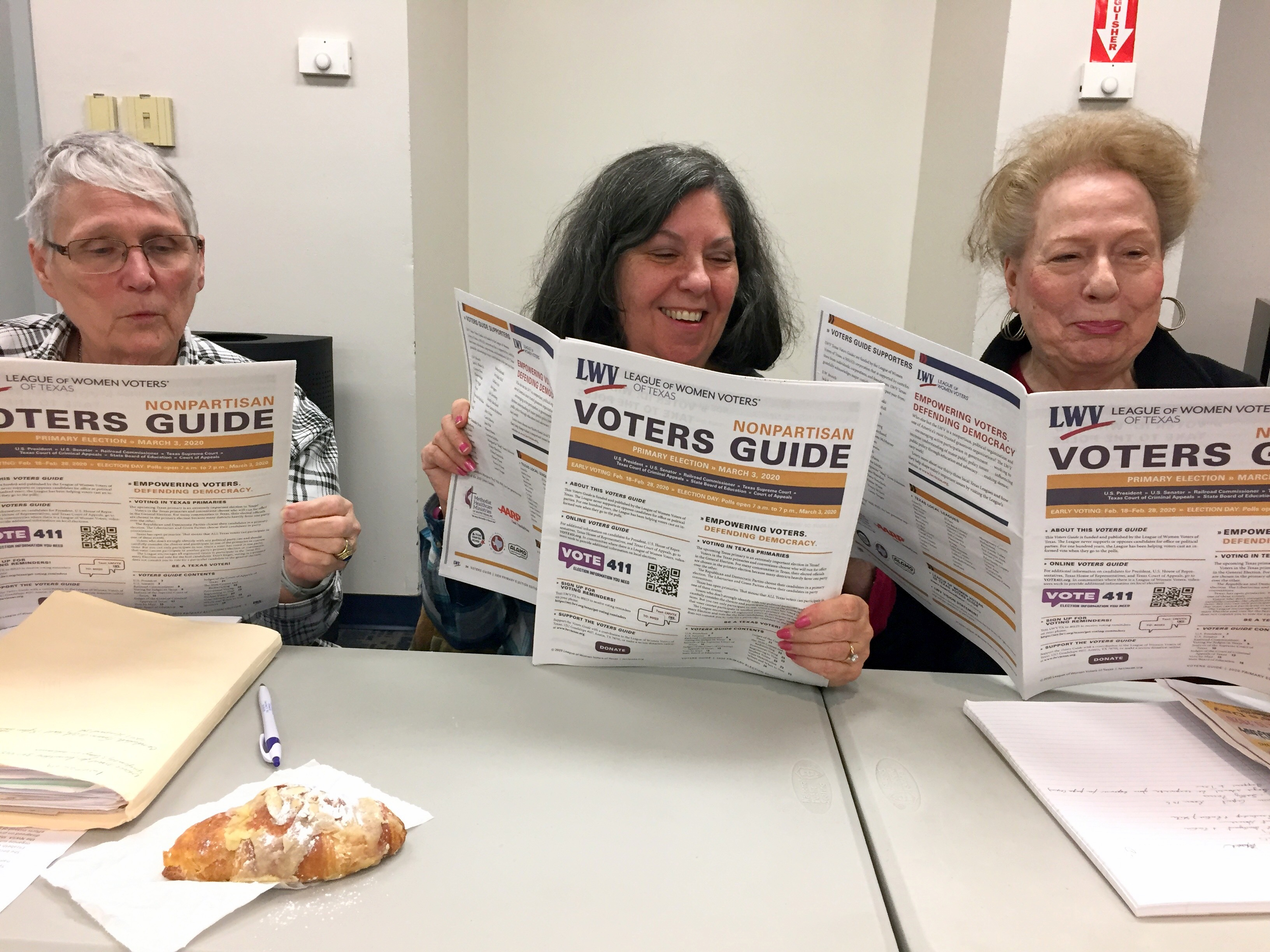 3 women holding Voter Guides