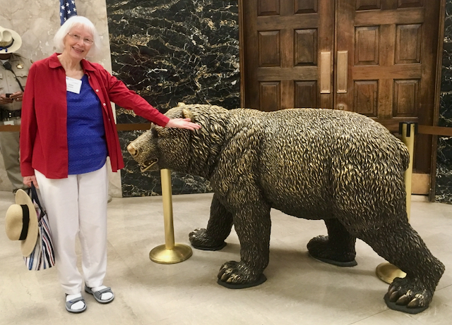 Photo of Woman with the bear at the State of California Capital