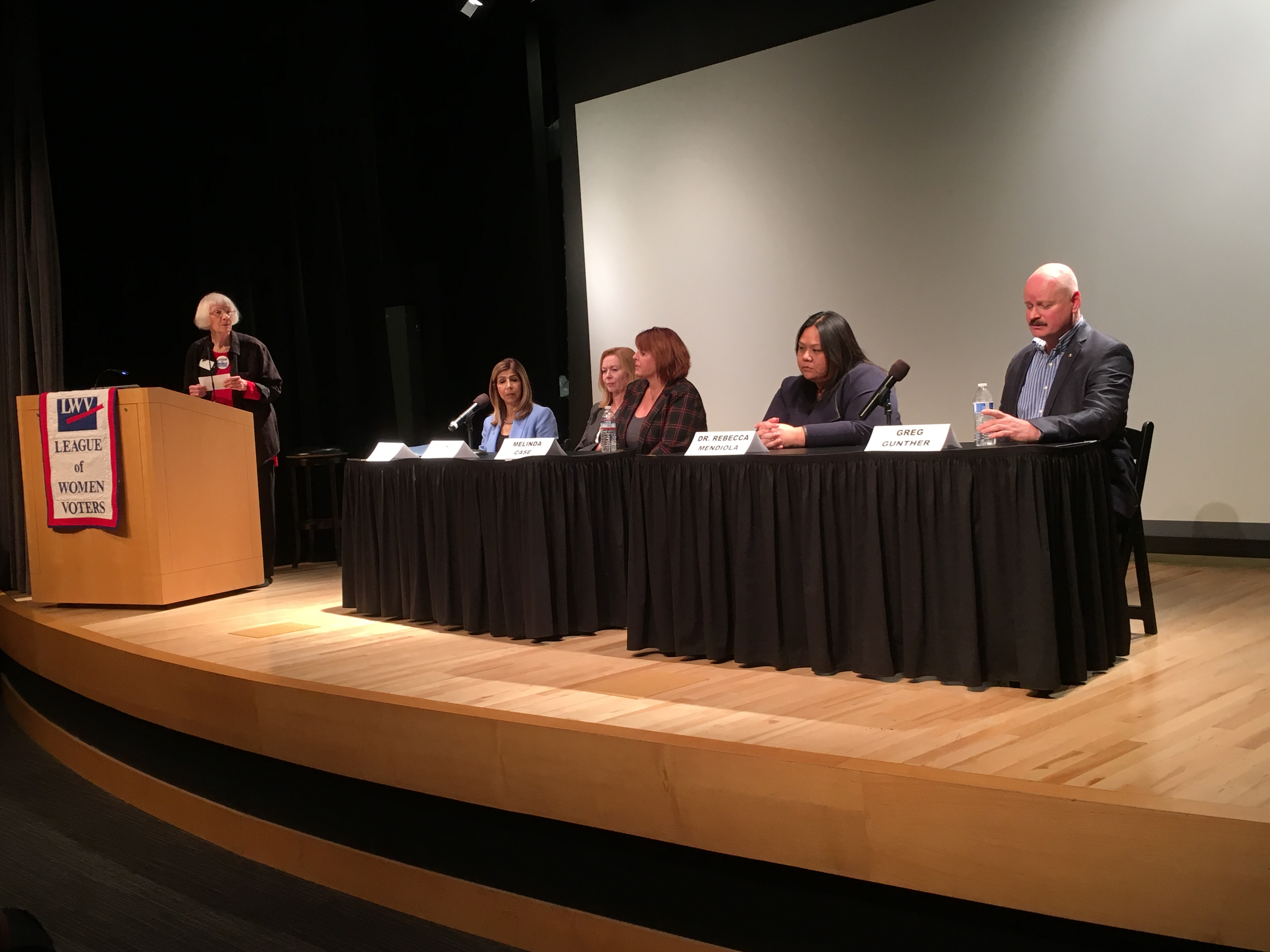 Photo of panel at our forum on Guns in the Community