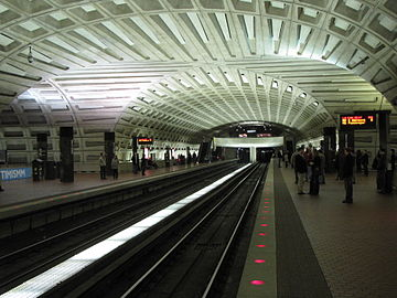 Picture of inside of Metro Center station in DC, showing a vaulted ceiling