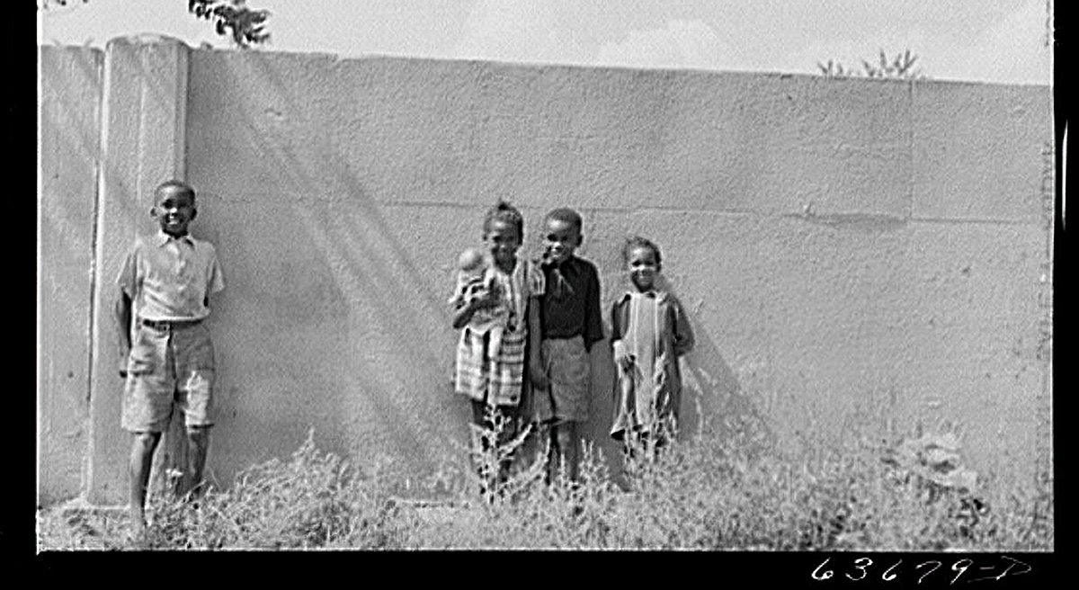 Children standing by Birwood Wall in Detroit, Michigan in the 1940s