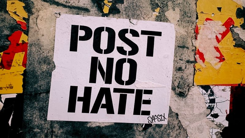 "Wall with grafitti "" Post No Hate """
