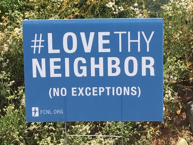 "Yard Sign Reading ""Love Thy Neighbor"""