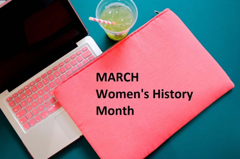 "pink laptop computer with ""March - Women's History Month"""
