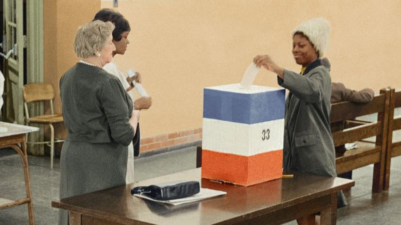 A woman casting her ballot
