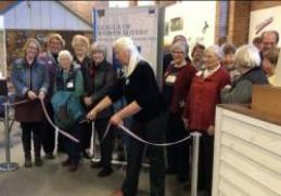 Cutting ribbon at Anoka History Center Opening