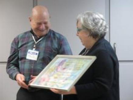 Bruce Promerantz receiving award