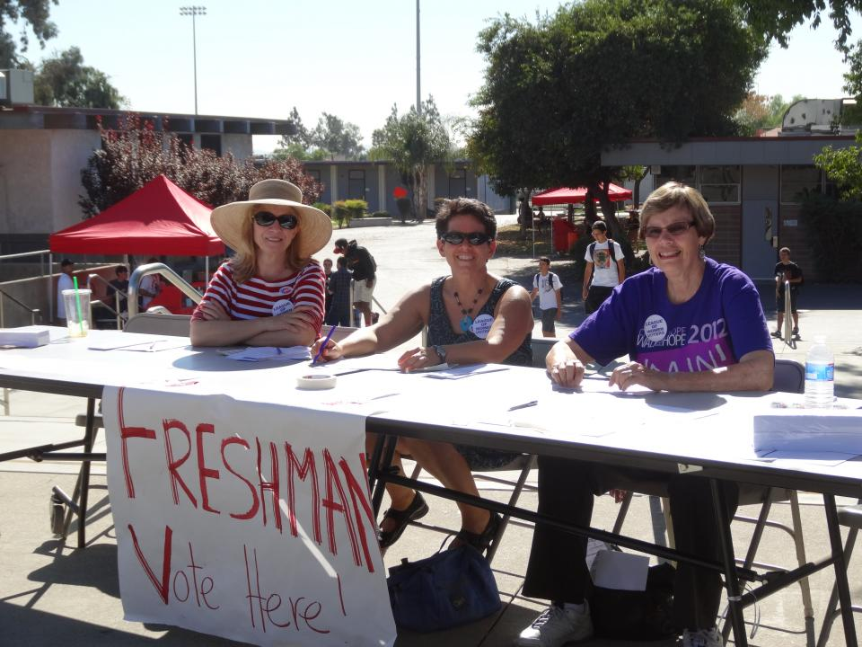 League members assist with a mock elction at Claremont High School to encourage voter engagement.