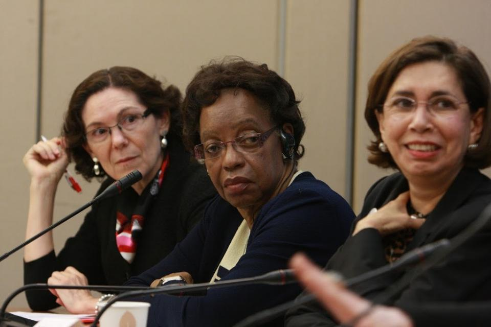 Three women discussing judicial diversity