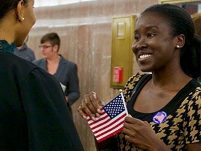 Woman w flag meeting legislator
