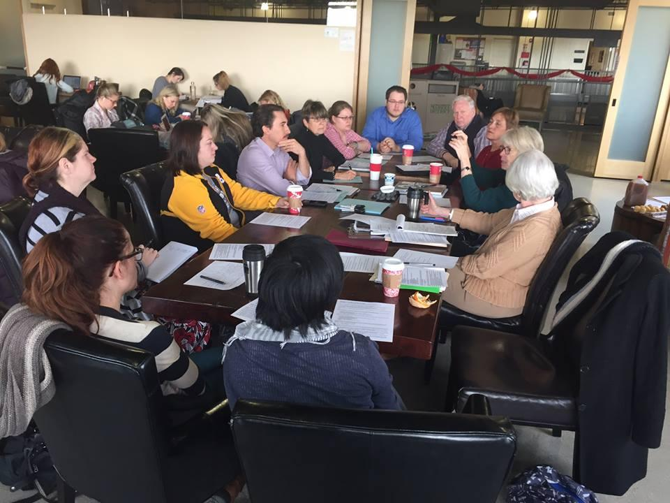 League study group discussion around a table