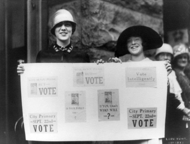 Suffragettes Holding Voting Banner