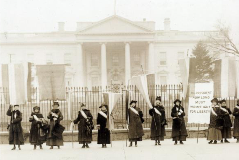 Suffragists with posters in air