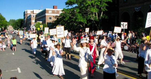 picture by Jeannette Wuff of members in white suffragette costumes in the July 4th parade in Montpelier 2018