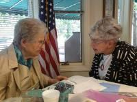LWV Manchester League members Alice Krasner and May Gruber celebrating Alice's 100th birthday in 2012