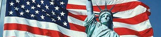Header image of Statue of Liberty in front of waving USA flag