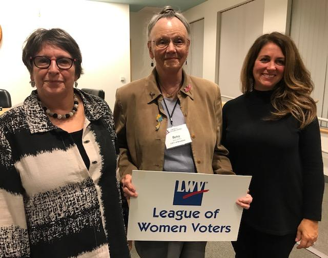 "Brookline League President Betsy Dewitt is flanked by the two speakers at Opening Meeting. To her right is Tina Cassidy, author of ""Mr. President, How Long Must We Wait?"" who spoke about her book on women getting the right to vote. On her left is local hi"