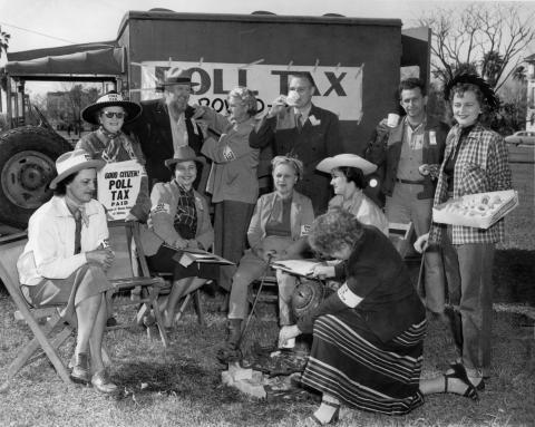 League women with poll tax signs