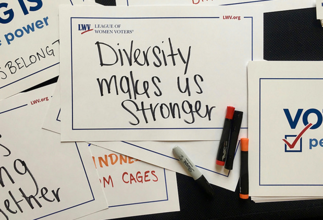 "League signs - ""Diversity Makes Us Stronger"""