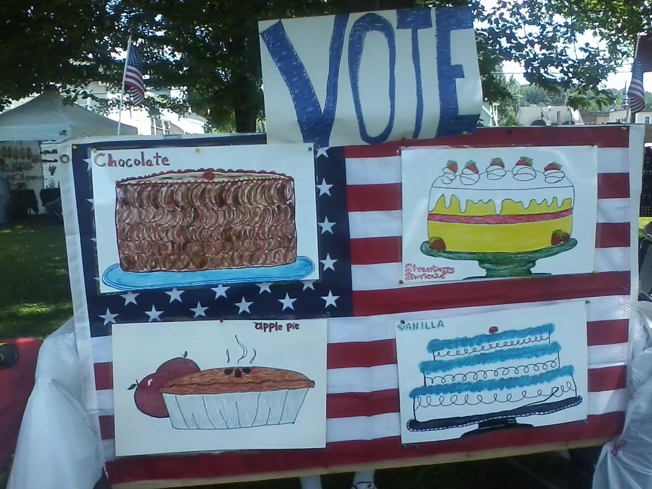 Display of Hand-drawn pictures of four desserts to vote for in mock election