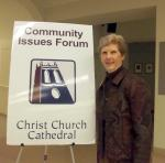 "League member with sign: ""Community Issues Forum - Christ Church Cathedral"""