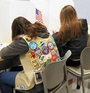 LWV Kent Voter Girl project-Girl Scouts with badges
