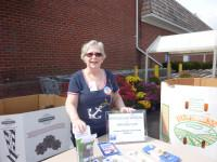 Joanne McEvoy-Samborn registering voters at National Voter Registration Day