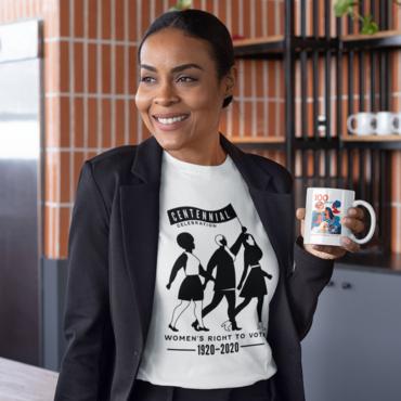 photo of woman wearing centennial t-shirt and holding mug