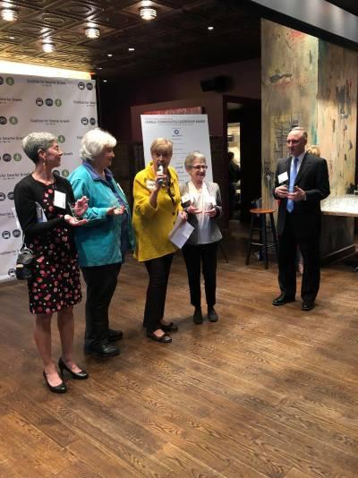 Picture of LWV representatives from LWV-VA(Deb Wake), LWVDC (Anne Anderson), LWVNCA (Kathy McGuire), LWVMD (Elaine Apter) receiving award from CSG Stuart SchwartzElaine A