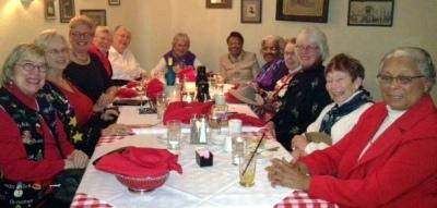 League members sit around the dinner table at Christmas party