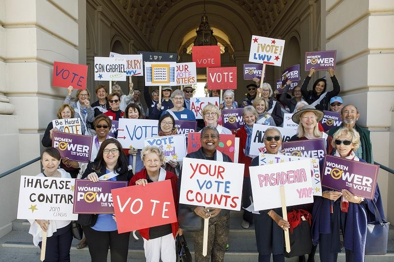 Group of People Holding Vote Signs Credit LWVUS