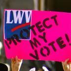 bright pink LWV Protect My Vote sign
