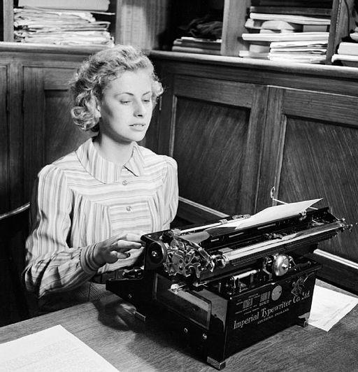 vintage photo of woman at typewriter