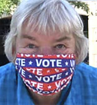 Jane H. wearing VOTE mask