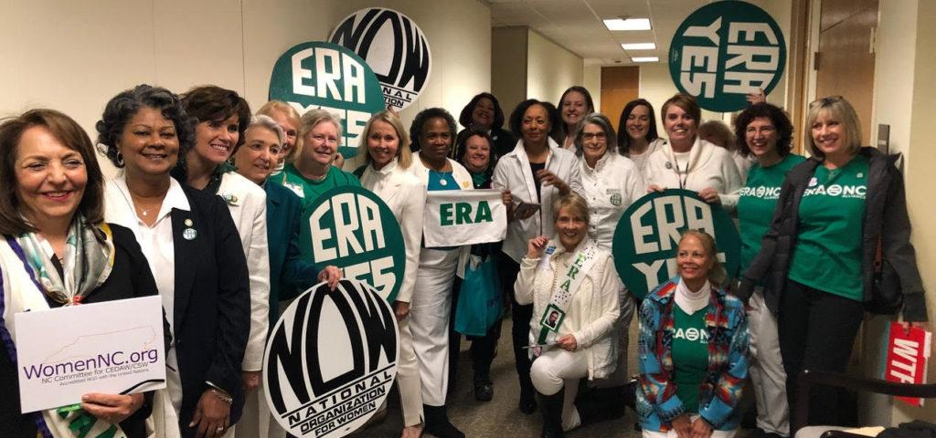 LWVNC members with Equal Rights Amendment signs pose in group