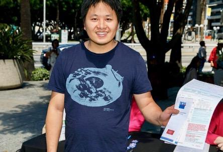 Man holding voter registration form