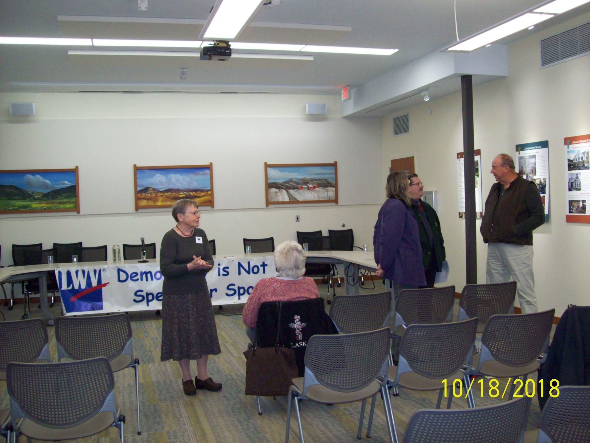 Kate Rader, Director of LWVCV greeting public