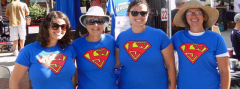 Four LWV members wearing blue super LWV tee shirts