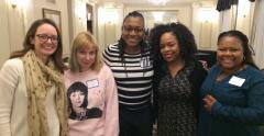 Members pose with Kina Collins at a Chicago in Focus event