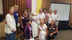 Group of women with manikin dressed as suffragist