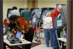 photo of Texas voters in the process of voting.