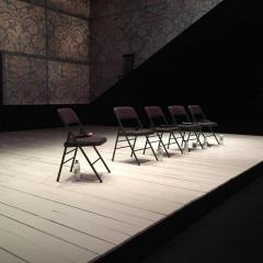 empty folding chairs on stage
