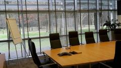 generic meeting room with tables, chairs, easel