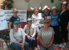Mason County Board Members at a board retreat don a variety of hats to signifying the many hats they wear, the roles they have taken on, as League board members.